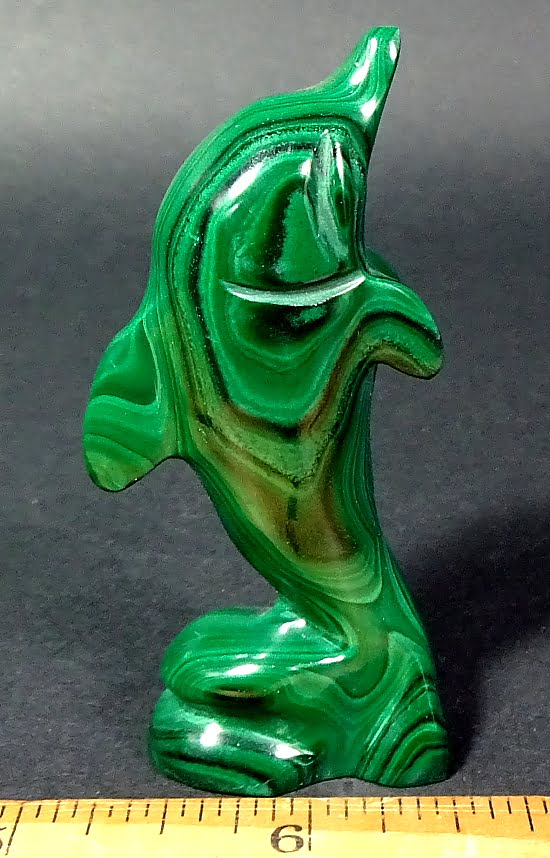 carving of a Dolphin made from Malachite