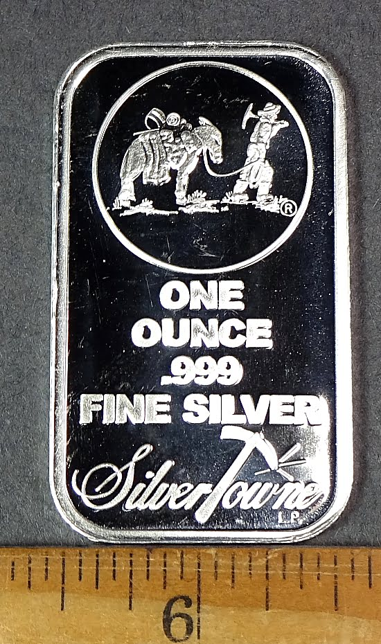 1 oz. Silver bar stamped with a miner and mule