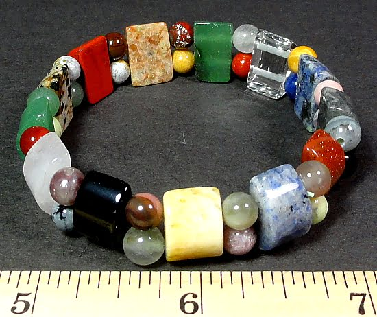 multi colored stretch bracelet made from half circle and round variety of gemstone beads