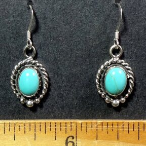 Turquoise cabochons mounted in a Sterling Silver setting