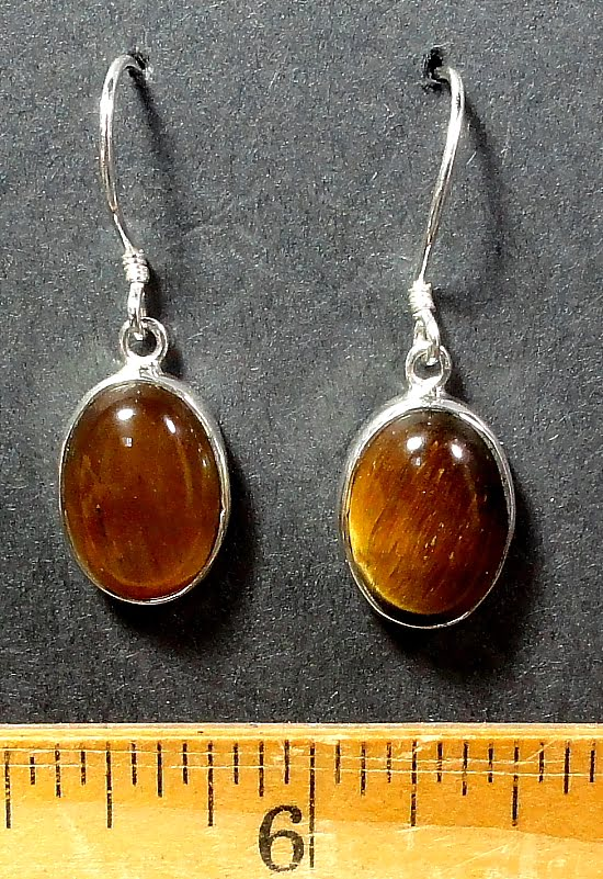 Tiger Eye cabochon mounted in a Sterling Silver setting