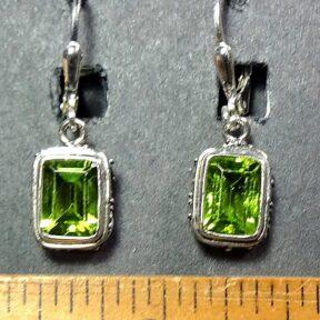 Peridot Earrings mounted in a decorative Sterling Silver setting