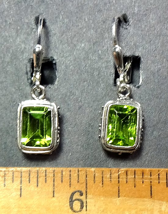 Peridot Earrings mounted in a decorative Sterling Silver setting