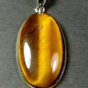 Sterling Silver pendant with a 20mm x 35mm Tiger Eye cabochon