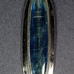 Kyanite pendant resting in a very nice sterling Silver setting