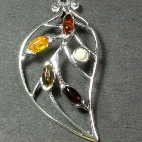 Silver Amber pendant with several small multi-colored Amber stones